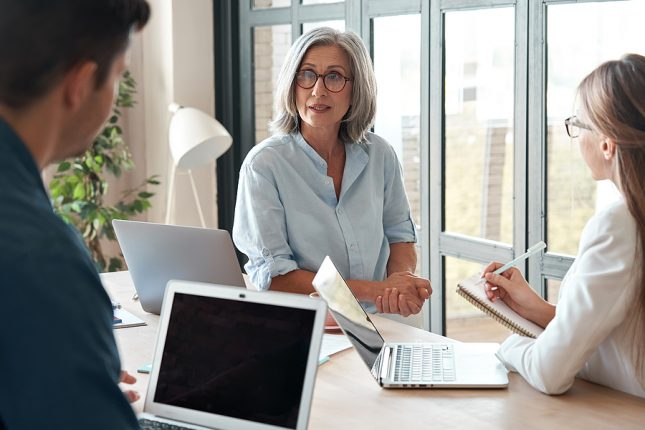 Businesswoman inquiring about managed it services in Sydney